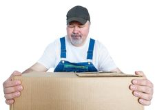 Worker psyching himself to lift a heavy box. Gripping it with his eyes closed and look of determination isolated on white Royalty Free Stock Image