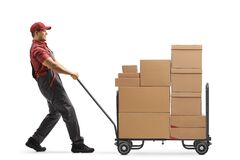 Free Worker Pulling A Hand Truck Loaded With Cardboard Boxes Royalty Free Stock Photo - 214138285
