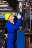 Worker pulling chains Stock Image