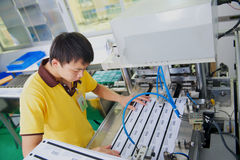 Worker punch plastic cards on factory Stock Photo