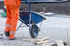 Worker pushing cart Stock Photography