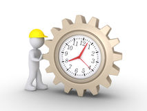 Worker pushing clock cogwheel Royalty Free Stock Images
