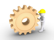Worker is pushing cogwheel Stock Image