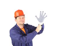 Worker put on the glove. Royalty Free Stock Image