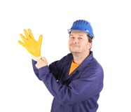 Worker put on the glove. Stock Photo