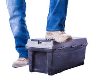 Worker put his foot on the toolbox Stock Photos