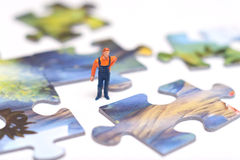 Worker put puzzles. The concept hard work Royalty Free Stock Photos