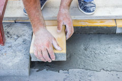 Worker puts concrete pavers 2 Stock Image