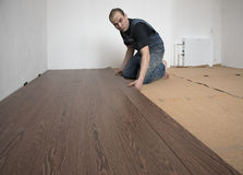 Worker puts laminate Stock Photography