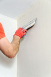 The worker puts the stucco on the wall Stock Photos
