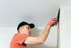 The worker puts the stucco on the wall Stock Photography