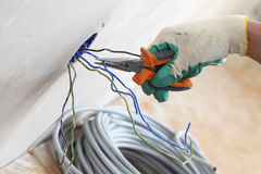 Worker puts the wires Royalty Free Stock Photos