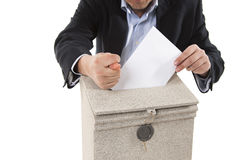 Worker putting letter in mailbox,showing a fig sign Stock Image