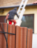 Worker putting new roof tiles on house Royalty Free Stock Images