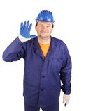Worker putting on rubber glove royalty free stock photo