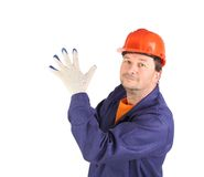 Worker putting on rubber glove. Stock Photography