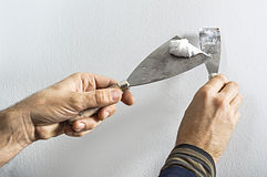 Worker with putty knife Royalty Free Stock Photography