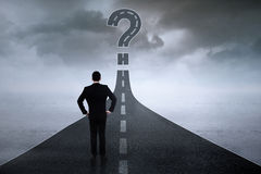 Worker with question sign on the road stock image