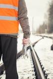Worker on railway crossings. Worker with adjustable wrench in the hands  on railway crossings Stock Image