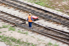 Worker on the railways concept. A man in an orange Royalty Free Stock Photo