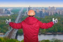 Worker with raised arms. Worker with his arms raised on a cityscape background Royalty Free Stock Images