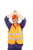 Worker raised hands over the head Stock Photo