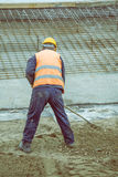 Worker with rake working 4. Worker with rake working on ground leveling at construction site. Vintage style Royalty Free Stock Photography