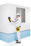 Worker rasping insulation panels Royalty Free Stock Image