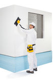 Worker rasping insulation panels Royalty Free Stock Photography