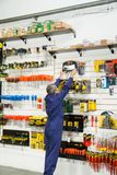 Worker Reaching For Bit Case In Shop Stock Photography