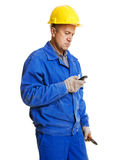 Worker reading message in his mobile phone Royalty Free Stock Photography