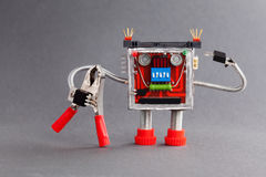 Worker ready for job. Serviceman robot character with red pliers. gray background Stock Image