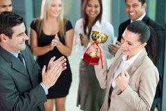 worker receiving  trophy Stock Photo