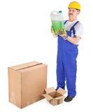 Worker recives delivery with green liquid Stock Photo