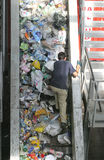 Worker at recycling plant Royalty Free Stock Images