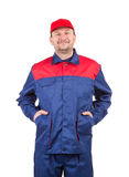 Worker in red-blue workwear. Stock Images