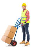 Worker in reflective clothes posing with a delivery cart Stock Photography