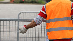 Worker with reflective jacket and gloves Royalty Free Stock Photos