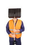 Worker in reflective waistcoat hiding face. Stock Photos