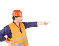 Worker in reflective waistcoat point the finger. Royalty Free Stock Images