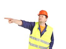 Worker in reflective waistcoat point the finger. Royalty Free Stock Photos