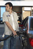 Worker Refueling Car At Station Royalty Free Stock Photo