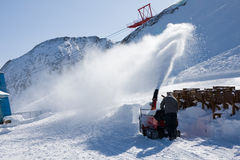 Worker remove snow with blower Stock Image