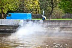 Kaliningrad city. Worker cleans the parapet of the Pregol River stock photos