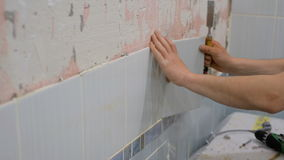 The worker removes the old ceramic tile stock footage