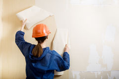 Worker removes old wallpaper royalty free stock photography