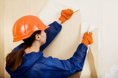 Worker removes old wallpaper stock images