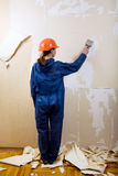 Worker removes old wallpaper Stock Photography
