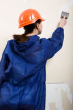 Worker removes old wallpaper Royalty Free Stock Photos