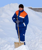 The worker removes the snow Stock Image